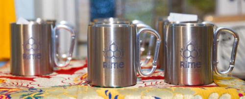 Rime Center logo carabiner mugs